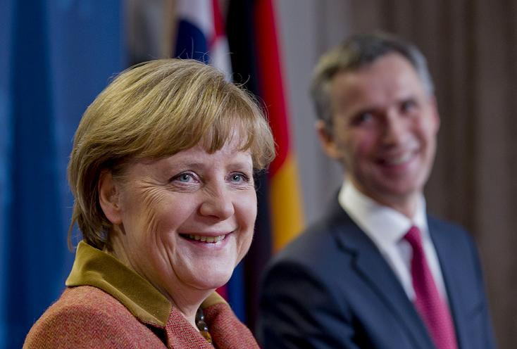 Norway's Prime Minister Jens Stoltenberg (R) and German Chancellor Angela Merkel address a press conference in Oslo on February 20, 2013. Norway's Prime Minister Jens Stoltenbergmet with Merkel for talks on a range of topics including energy supply. AFP PHOTO/ DANIEL SANNUM LAUTEN