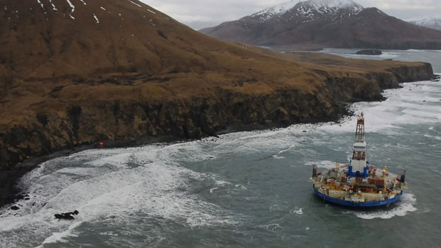 The conical drilling unit Kulluk, sitting grounded 60 kilometres southwest of Kodiak City, Alaska, on Thursday. (U.S. Coast Guard, Petty Officer 2nd Class Zachary Painter/Associated Press )