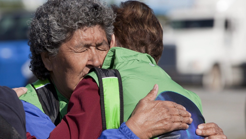Annie Gordon, 76, a survivor of residential schools, shares an emotional moment at the opening ceremonies of the Truth and Reconciliation Commission for residential school survivors in Inuvik, N.W.T., earlier this week. Photo by James Mackenzie, Canadian Press.