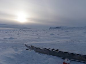 A komatik, an Inuit sled, on the frozen-over shore of Patricia Bay in Baffin Island's northeast.