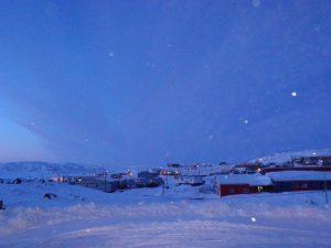 Twilight snowfall in Cape Dorset, Nunavut.