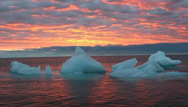 Ice chunks floats in the Arctic Ocean as the sun sets near Barrow, Alaska. AP Photo/Arctic Sounder, Beth Ipsen